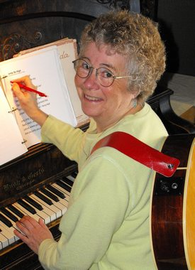 Rosemary with guitar at the piano 2016
